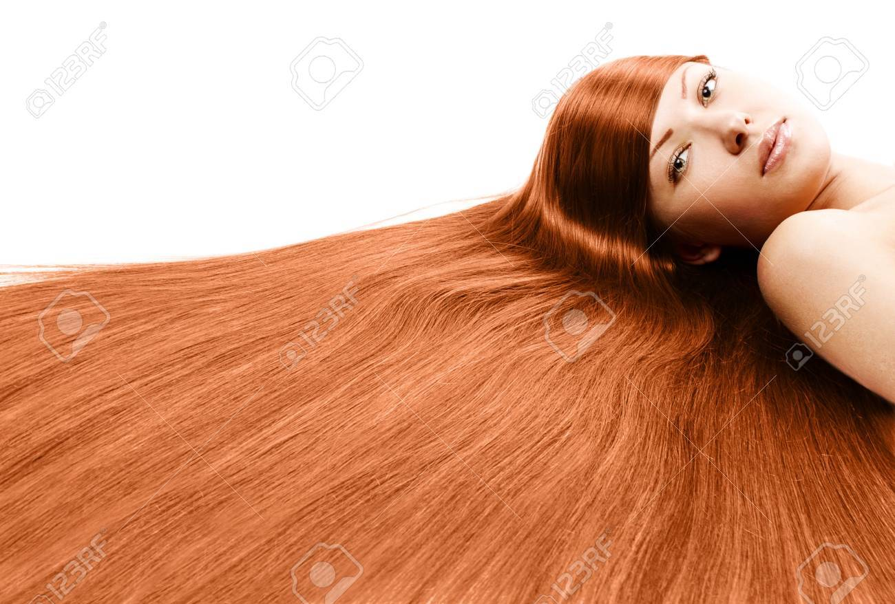 closeup portrait of a beautiful young woman with elegant long red shiny hair , hairstyle , isolated on white background , healthy straight hair Stock Photo - 15806382