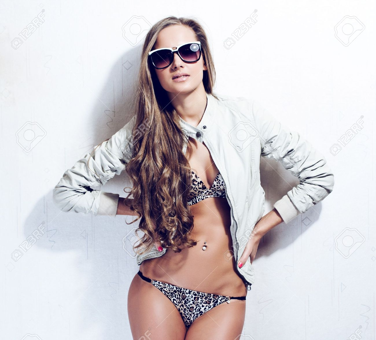 fashion model with long curly hair , posing at studio Stock Photo - 16166108