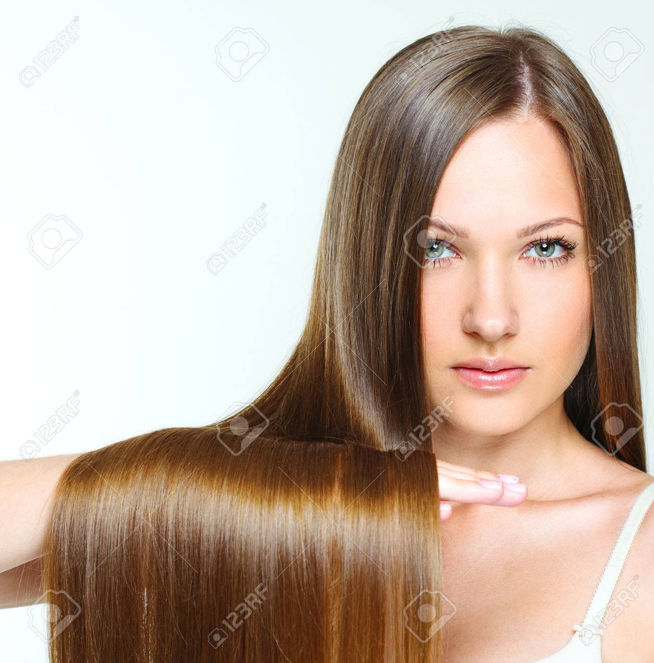 close-up portrait of a beautiful girl with brown long shiny hair. attractive girl with healthy long hair. natural hair. - 28215021