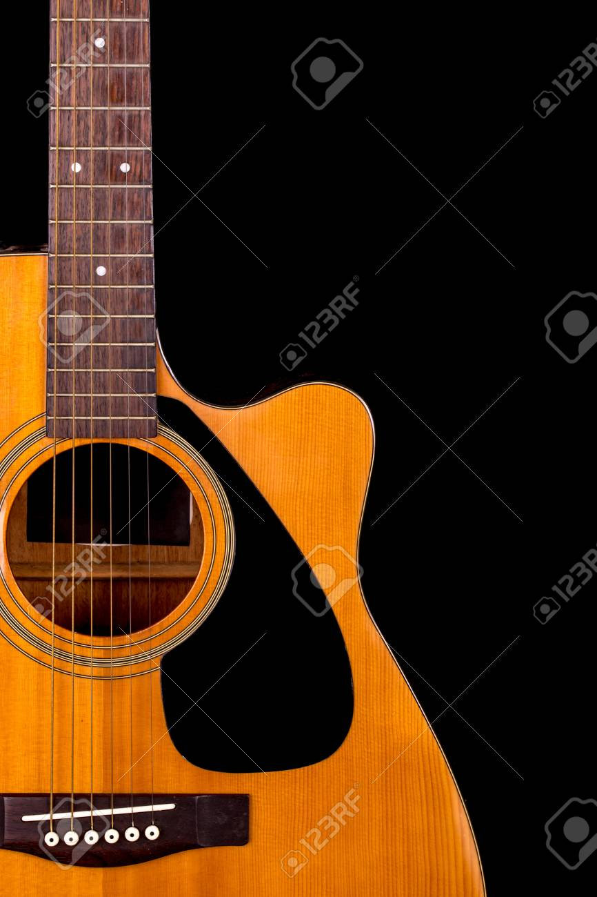 Acoustic Guitar Detail On Black Background Stock Photo Picture And