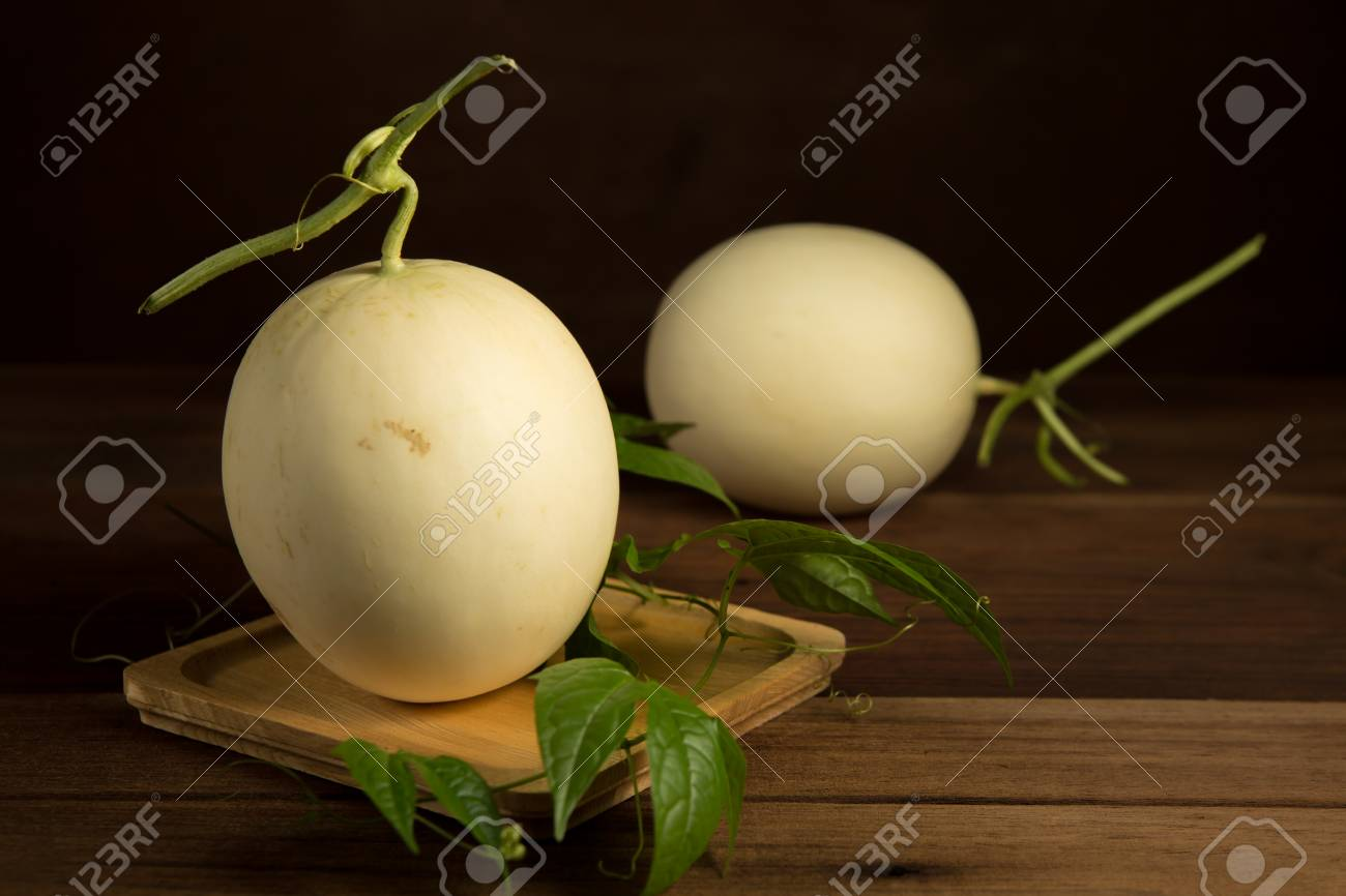 Yellow cantaloupe melon on the wooden background. - 60202030