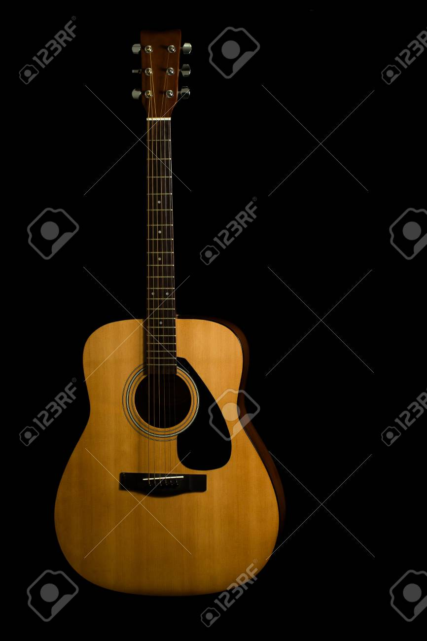 Acoustic Guitar On A Black Background With Copy Space Stock Photo