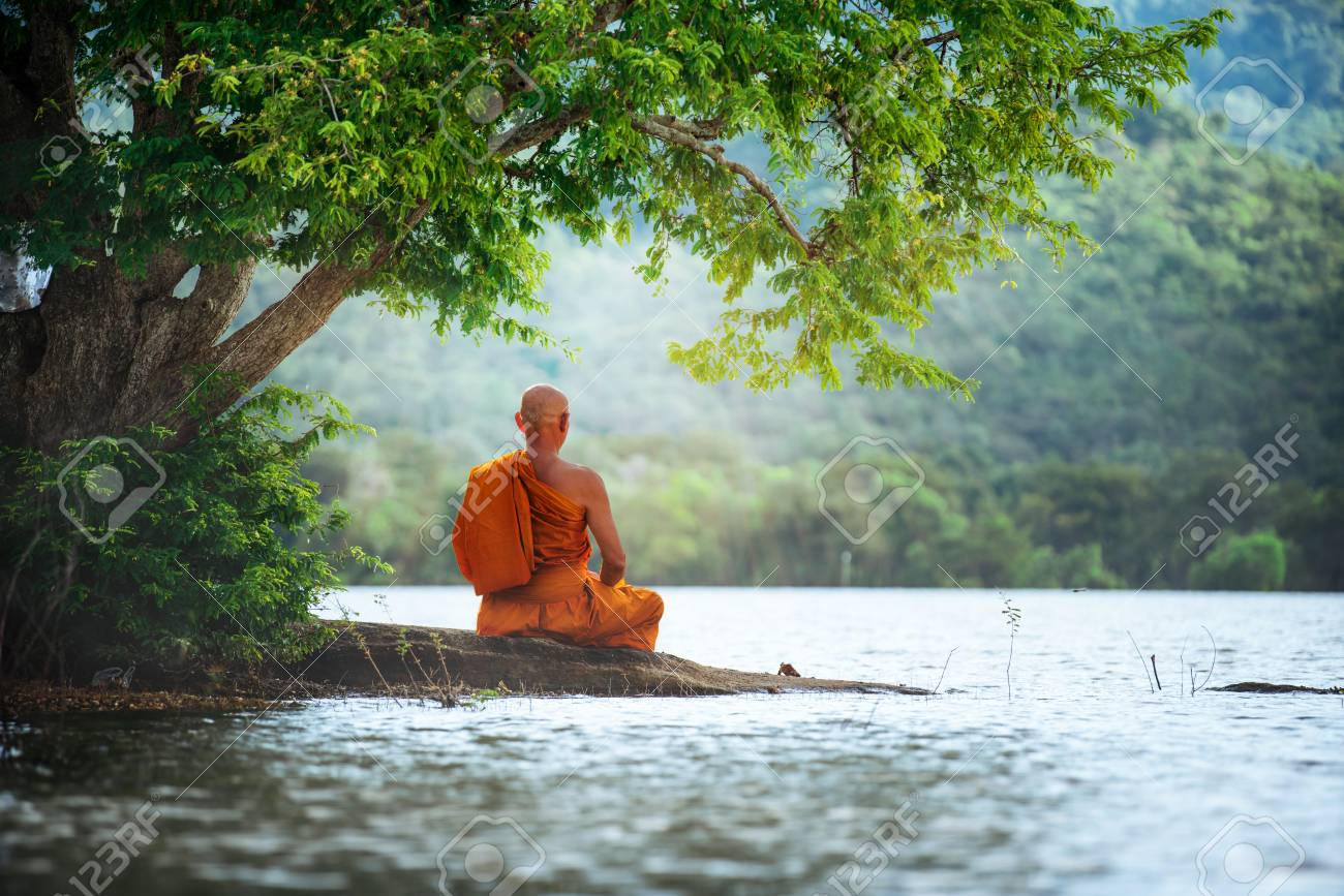 Buddhist Monk In Meditation Beside The River With Beautiful Nature Stock Photo Picture And Royalty Free Image Image 109222720