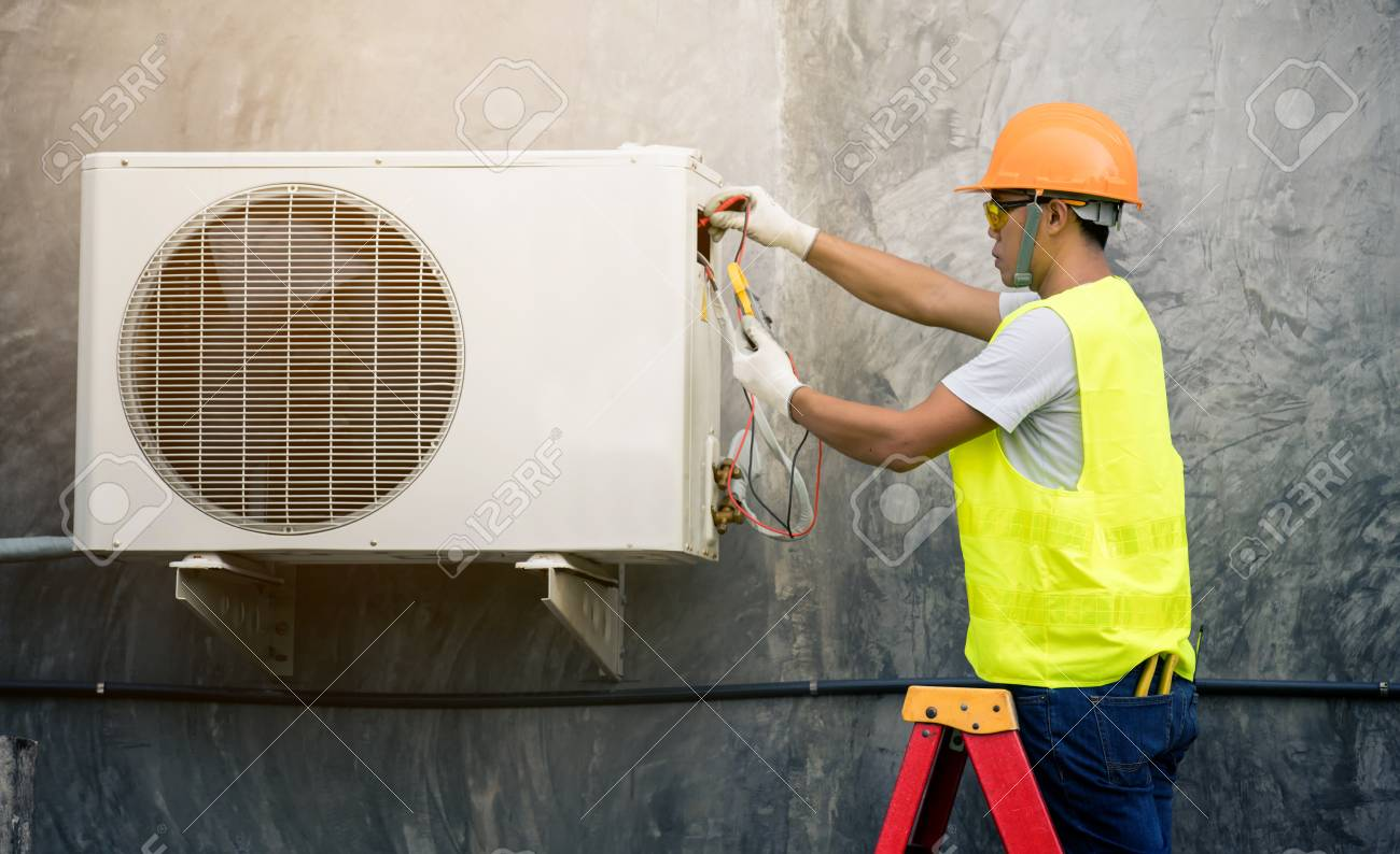 asian man runs the air-conditioning refrigerant from the tank - 111229800