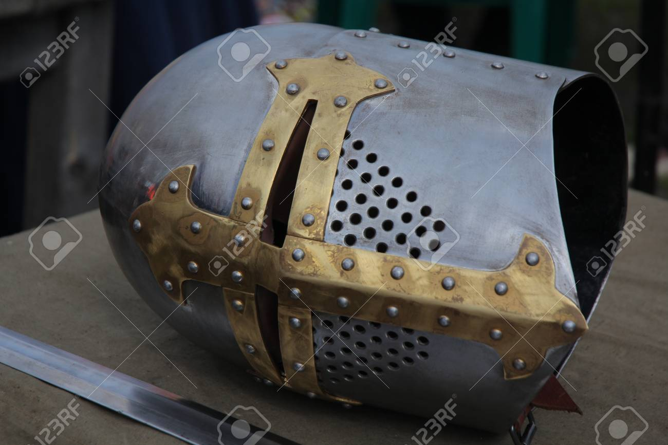 Part of a knight\u0027s medieval suit of armor. Helmet and sword beside..