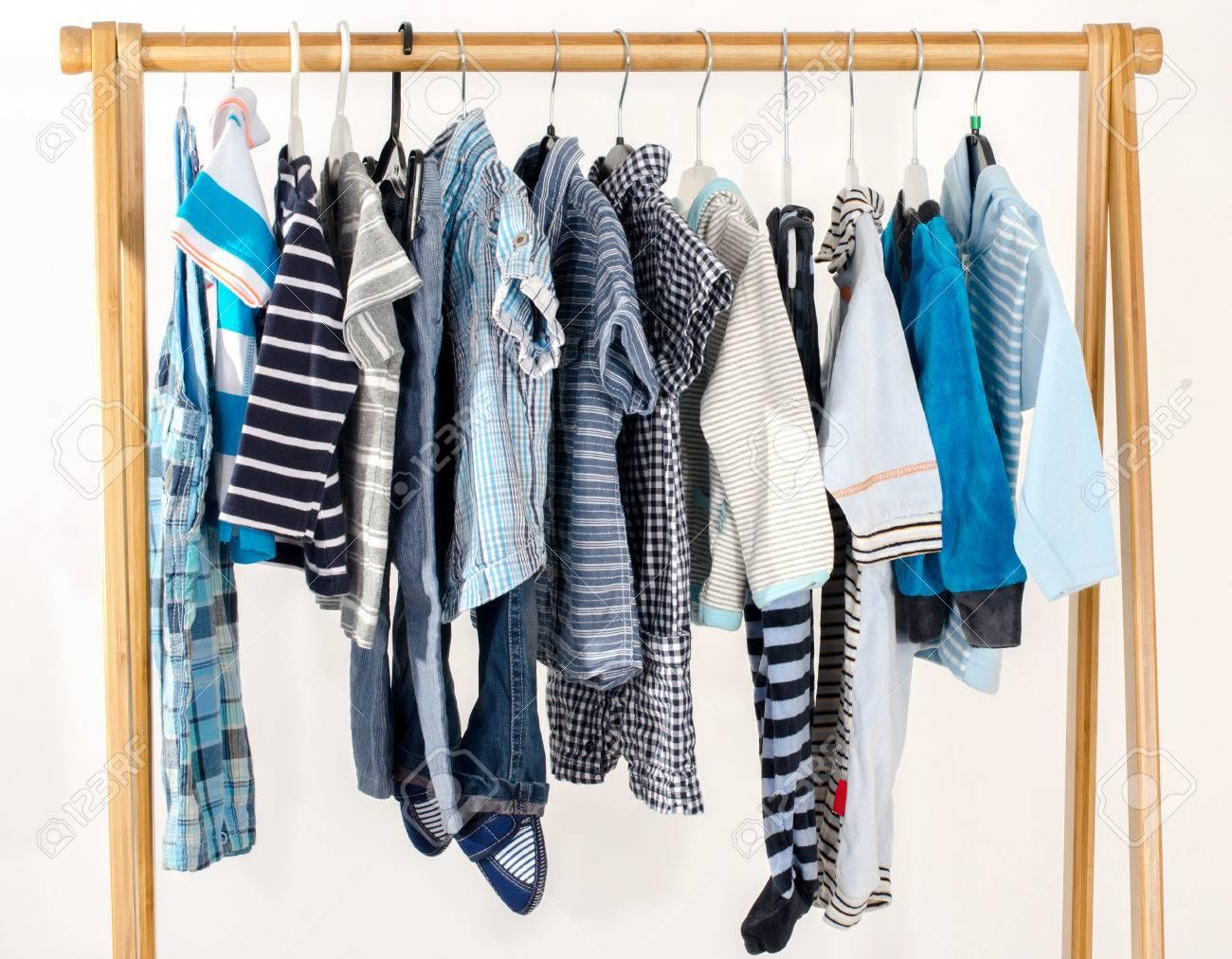 foto de archivo vestir armario con ropa dispuestas en hangersblue y armario blanco de recin nacidos nios nios bebs llenos de toda clothes
