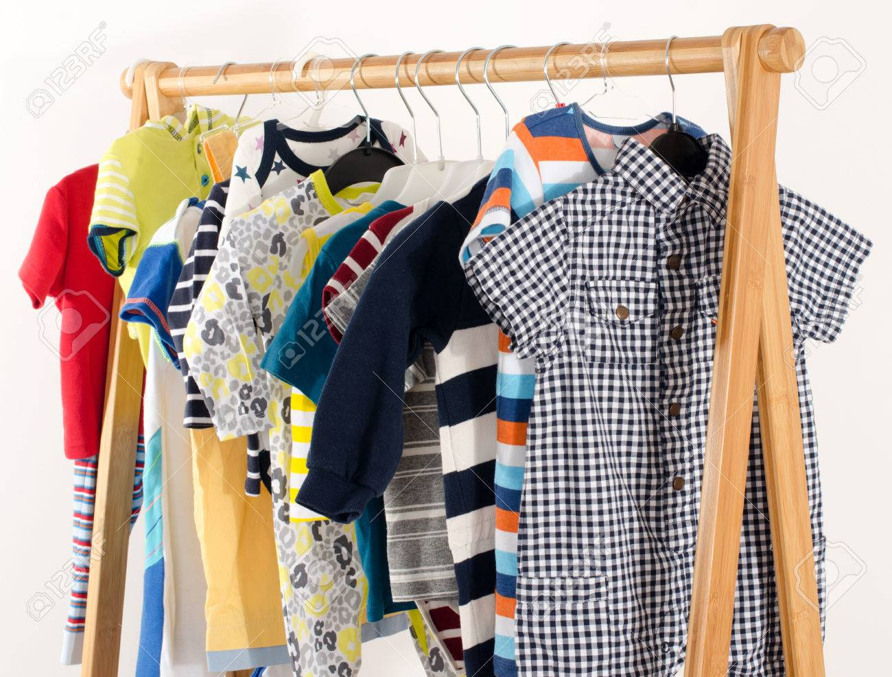 0f1d20460 Dressing closet with clothes arranged on hangers.Colorful wardrobe..