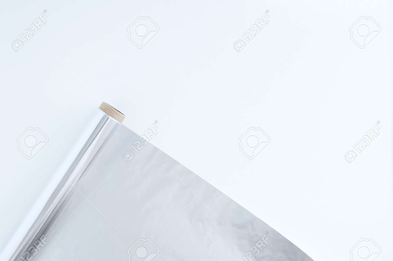 A roll of foil for baking. White background. Kitchen utensils. - 166501123