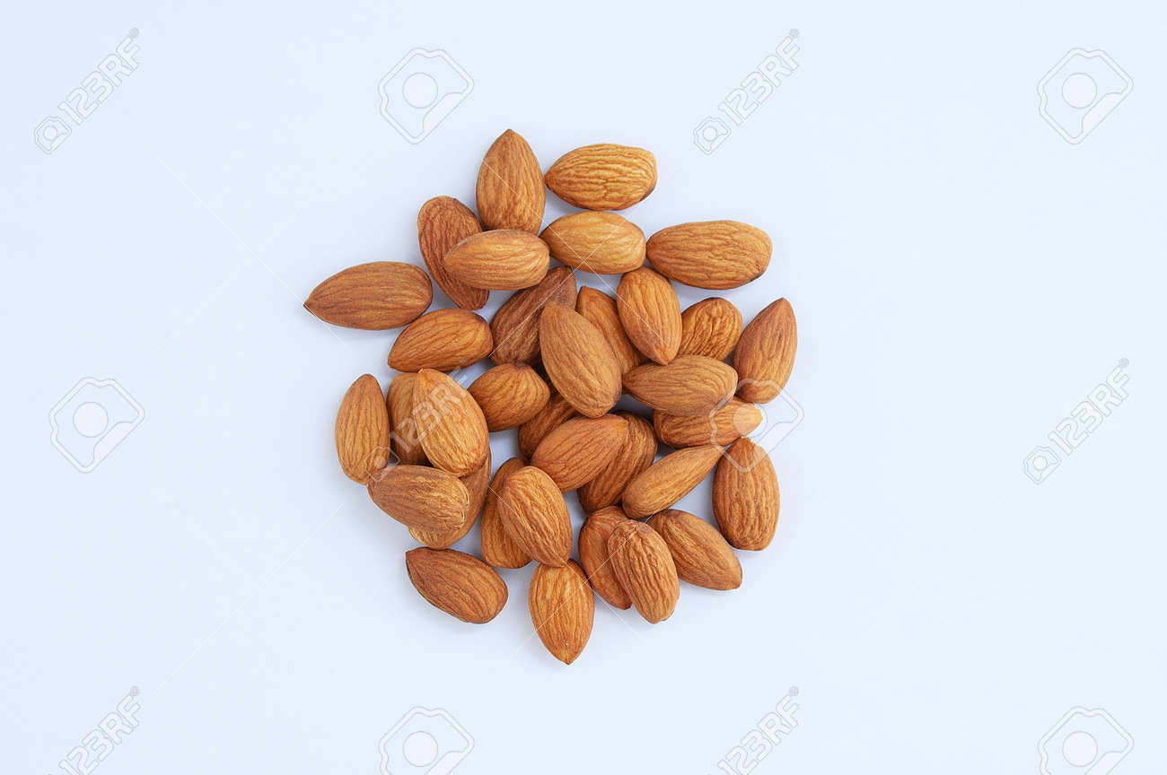 A handful of heap of peeled almonds on a white background. - 166396200
