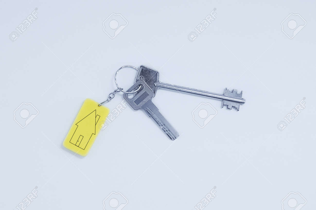 Real estate concept. Keychain with keys with black lines sketch of a house. - 171572989