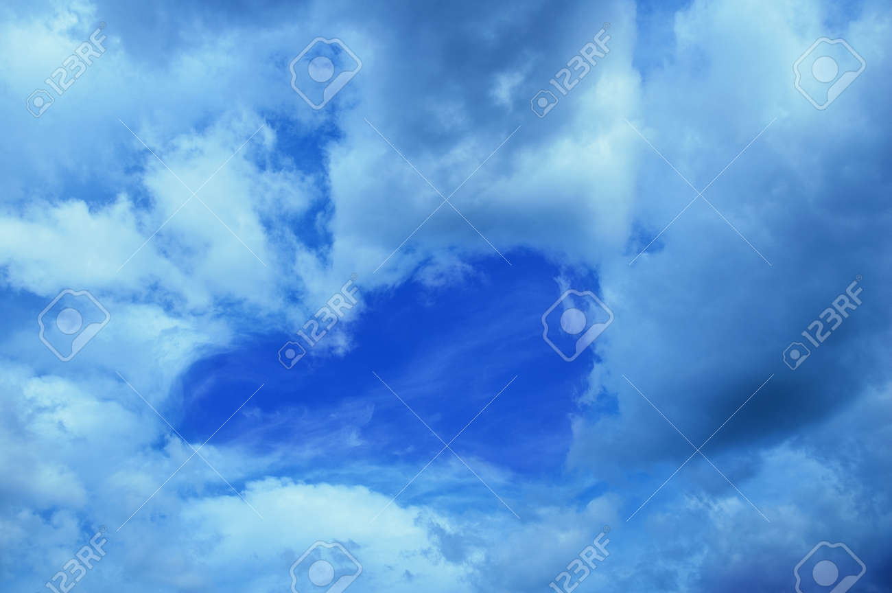 Blue sky with clouds in the shape of a heart during the day outdoors. - 172232570