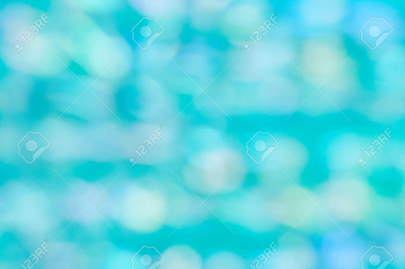 White bokeh on a turquoise background. Blurred focus. - 172753663