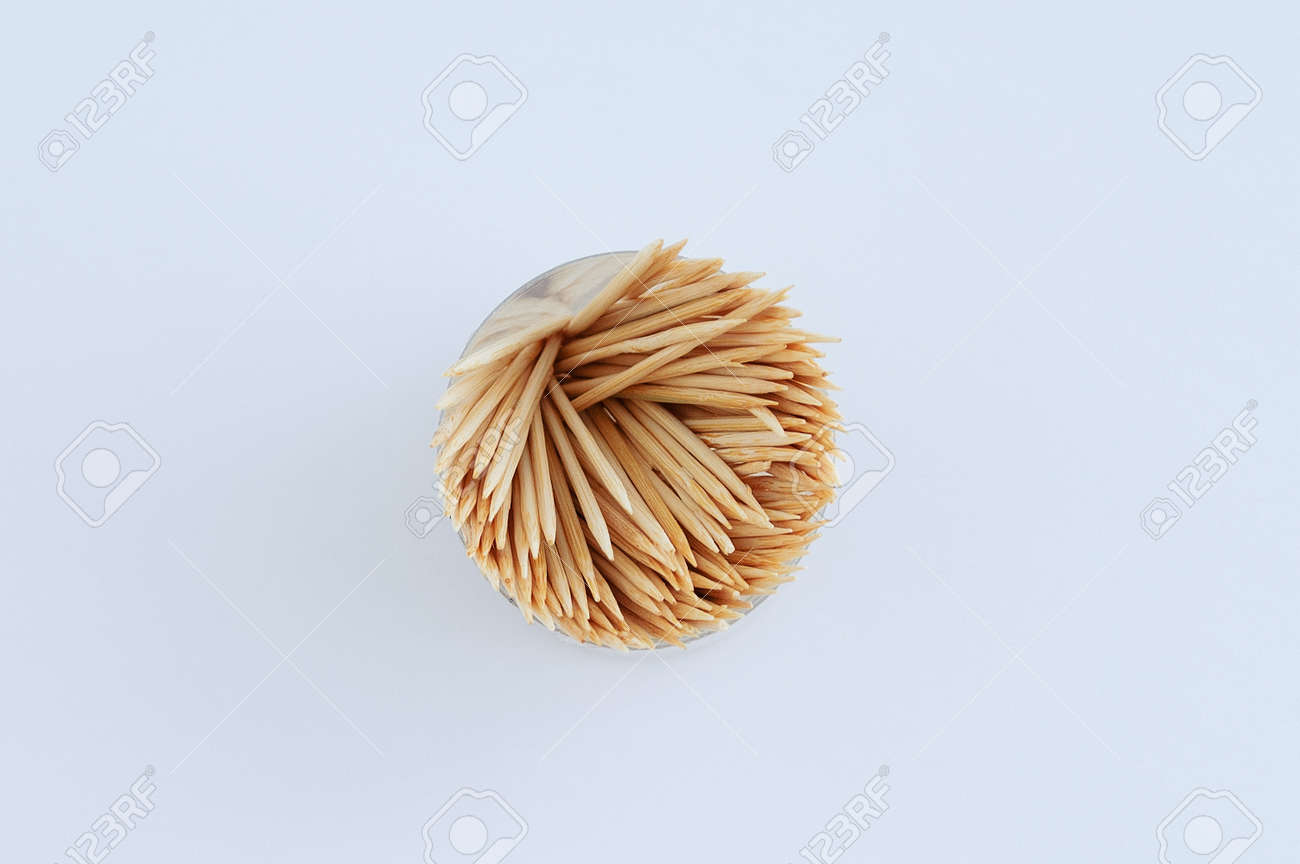 Wooden toothpicks in a round package on a white background close-up. - 173072761