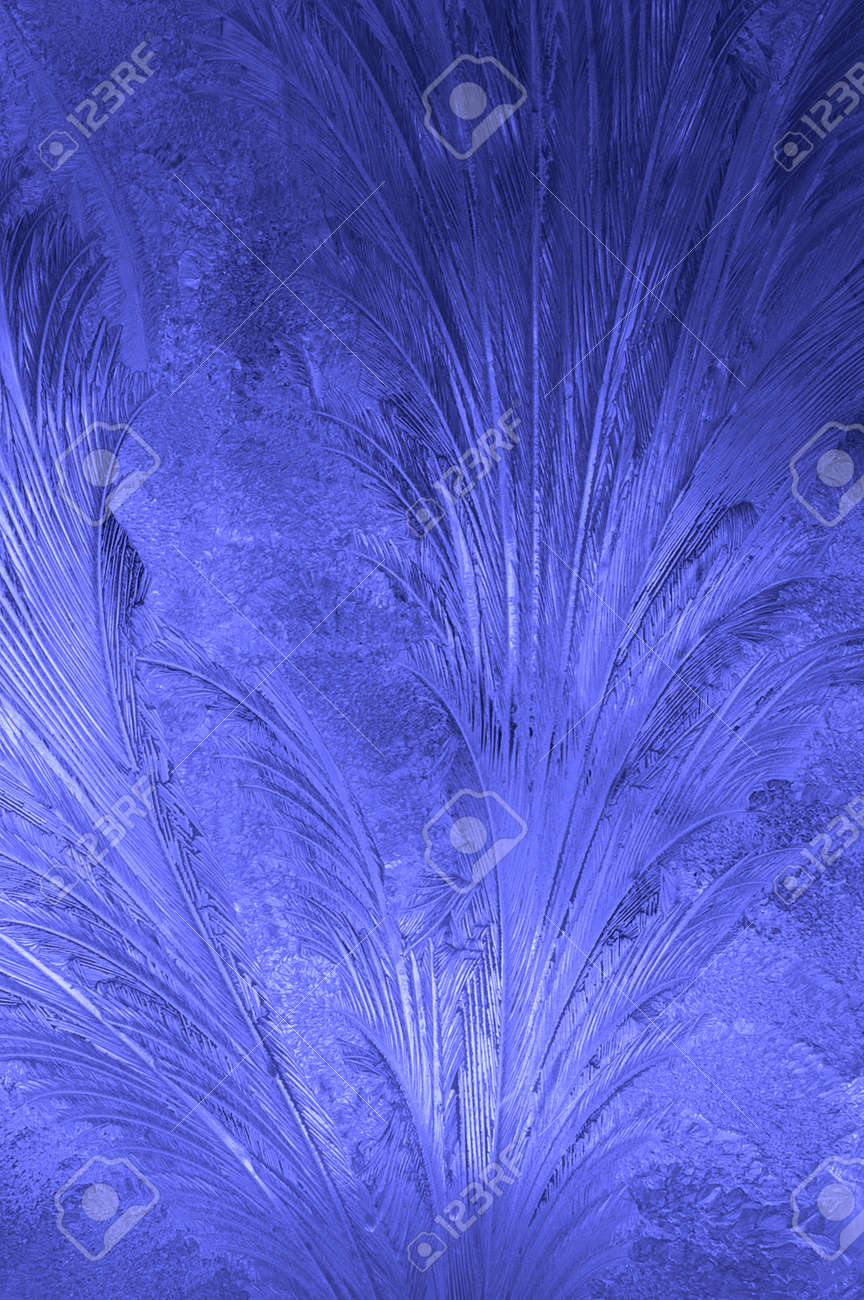 Frosty pattern of hoarfrost on glass close-up. Vertical photo. - 173071451
