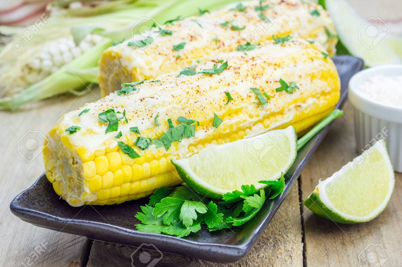 Mexican corn with butter, mayonnaise, parmesan, chili, cilantro, and lime - 44274090