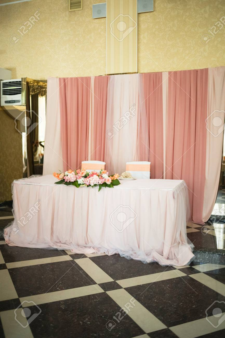 Beautiful Wedding Decorations In Peach Color With Fresh Flowers