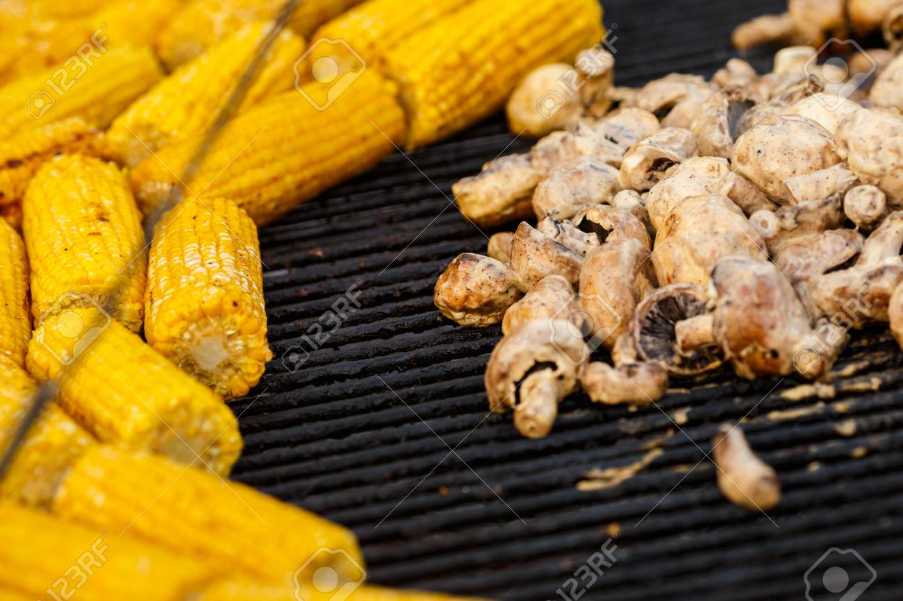 6d8c37bb40c0 Champignon white mushrooms grilled on grill or BBQ steam. Cooking mushrooms  on the grill.