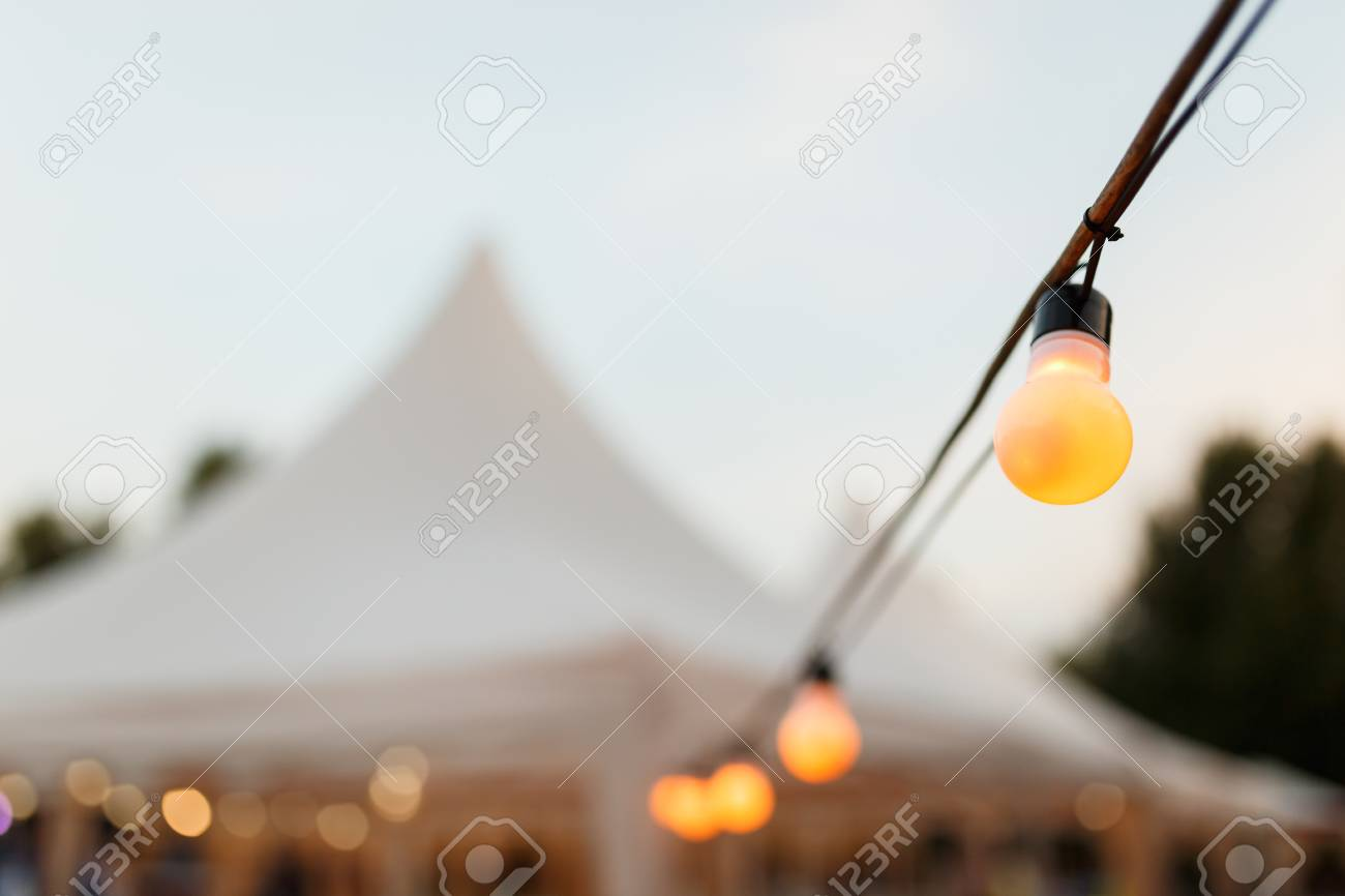 String Wired With Warming Light Bulbs Hanging In The Area Of.. Stock ...