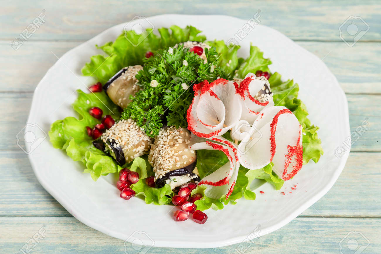 Salad with vegplant rolls and vegetables. - 120348062