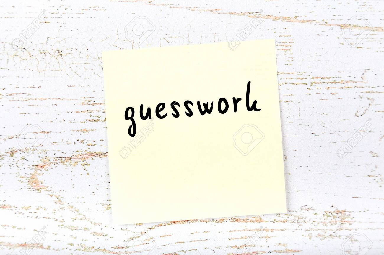 Yellow sticky note on wooden wall with handwritten inscription guesswork - 149518413