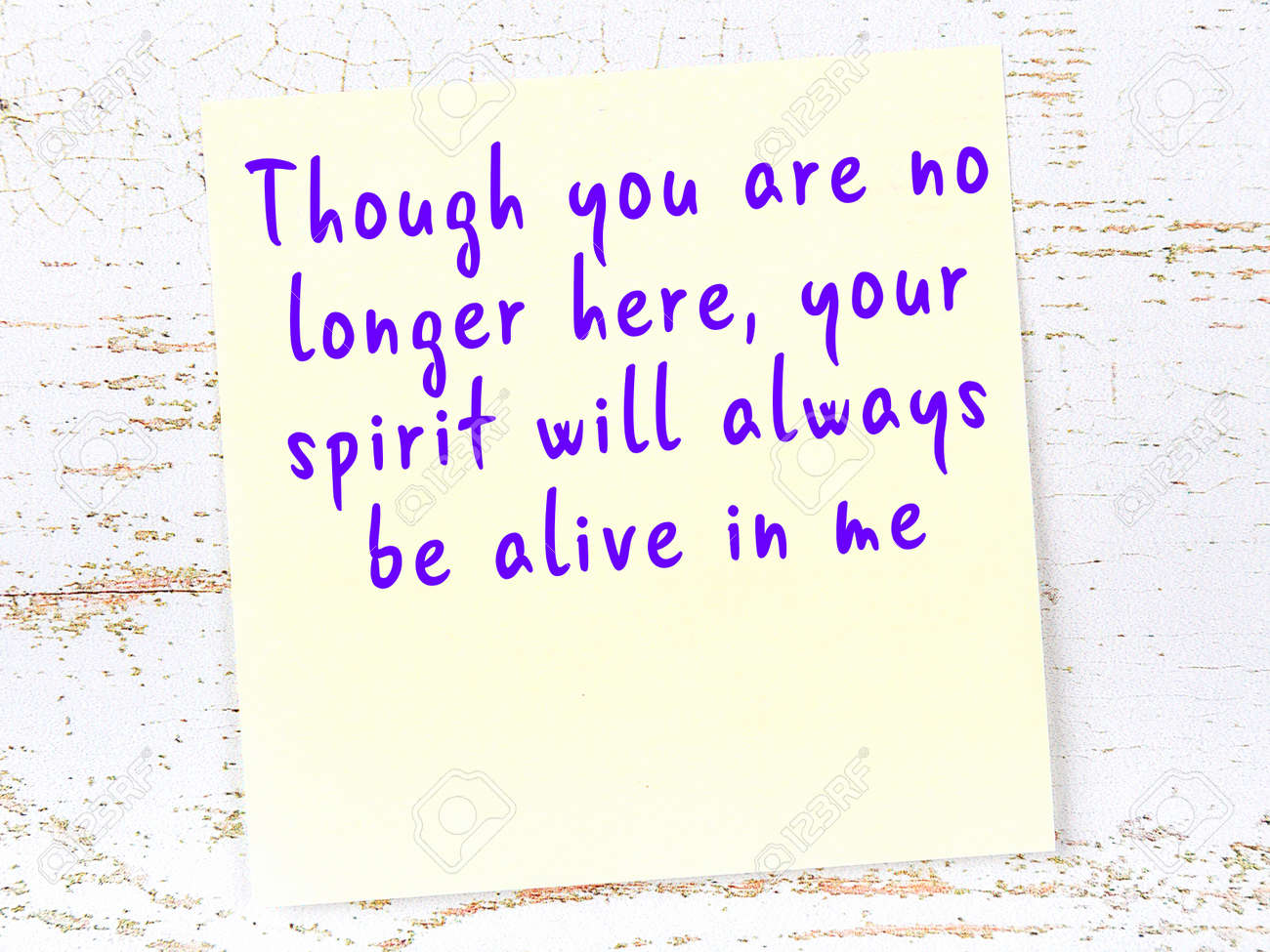 Yellow sticky note with handwritten motivational quotation on wooden wall - 165847026