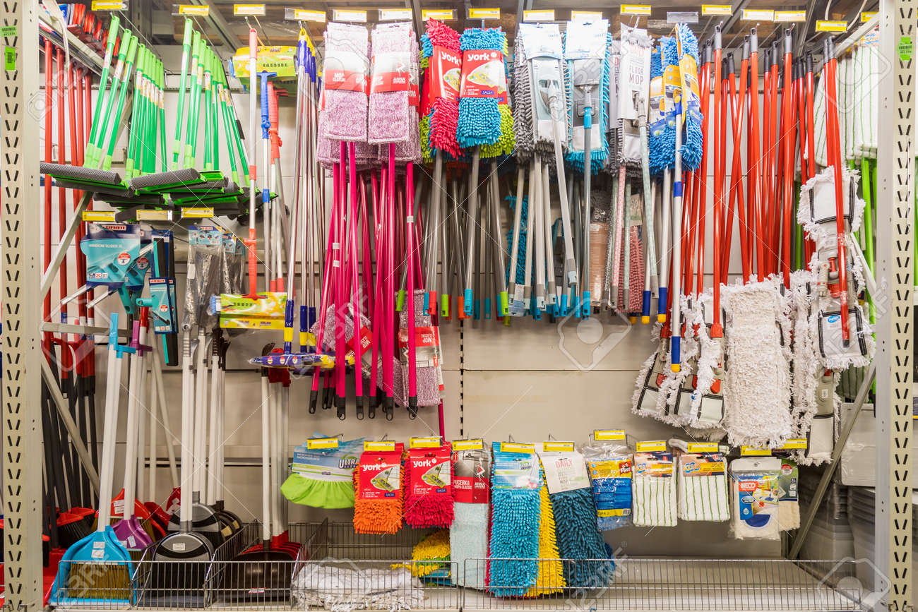 March 31, 2021 Balti Moldova, Supermarket or wholesale store by type of warehouse, department of cleanliness and household chemicals. Illustrative editorial. Showcase with mops - 167250871
