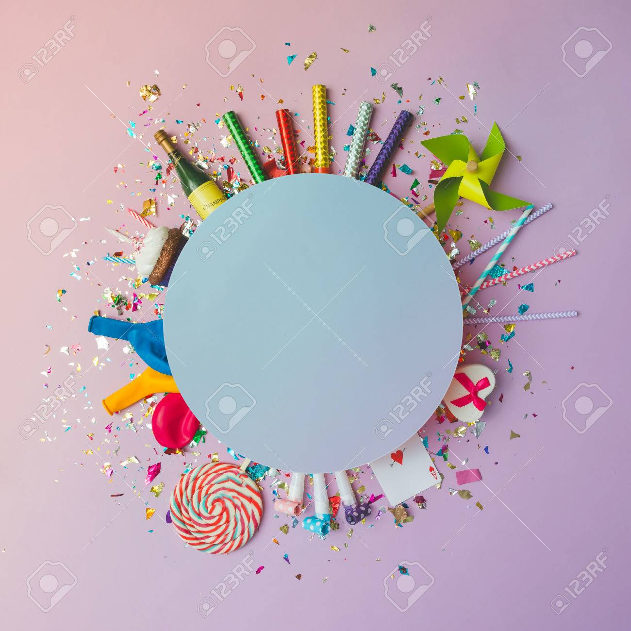 Colorful celebration background with various party confetti, balloons, streamers, fireworks and decoration on pink background. Flat lay. - 68075374