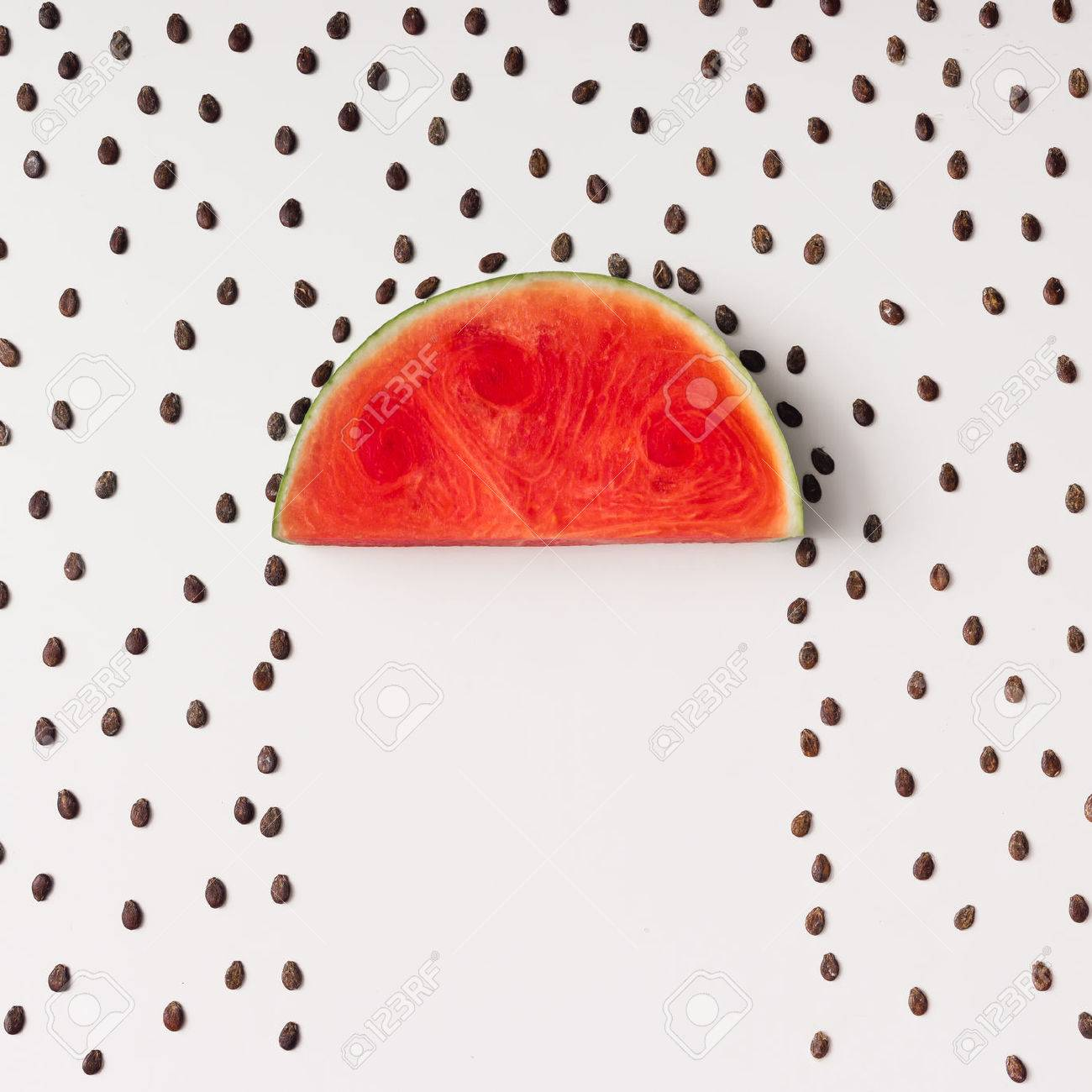 Watermellon slice with seeds raining. Flat lay. Weather concept. - 71536661