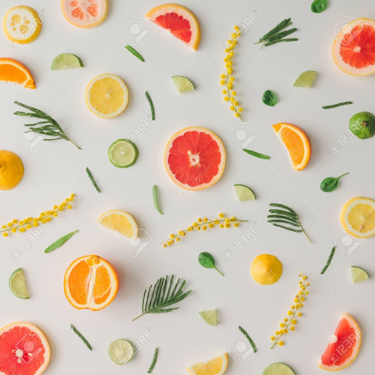 Colorful food pattern made of lemon, orange, grapefruit and flowers. Flat lay. - 73341852