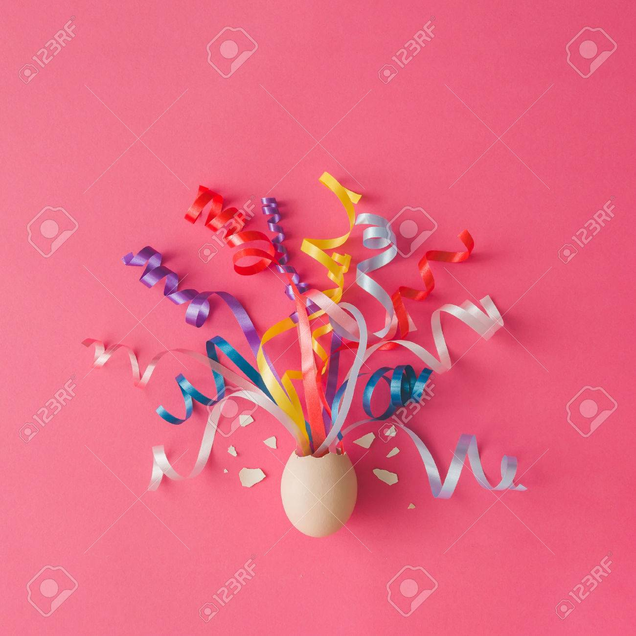 Egg with party streamers on pink background. Easter concept. Flat lay. - 74236934
