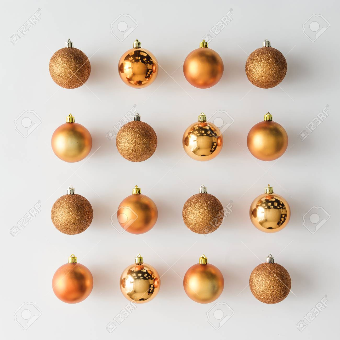 Golden Christmas baubles decoration on bright background. Flat lay. Holiday concept. - 89543785