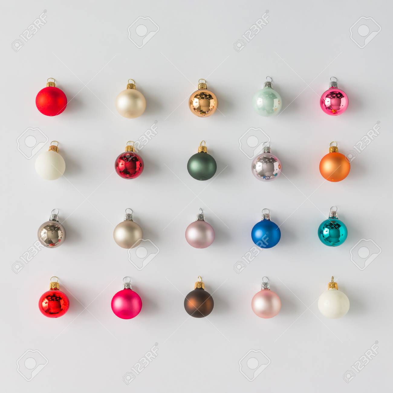 Colorful Christmas Baubles Decoration On Bright Background Flat Lay Holiday Concept Stock Photo