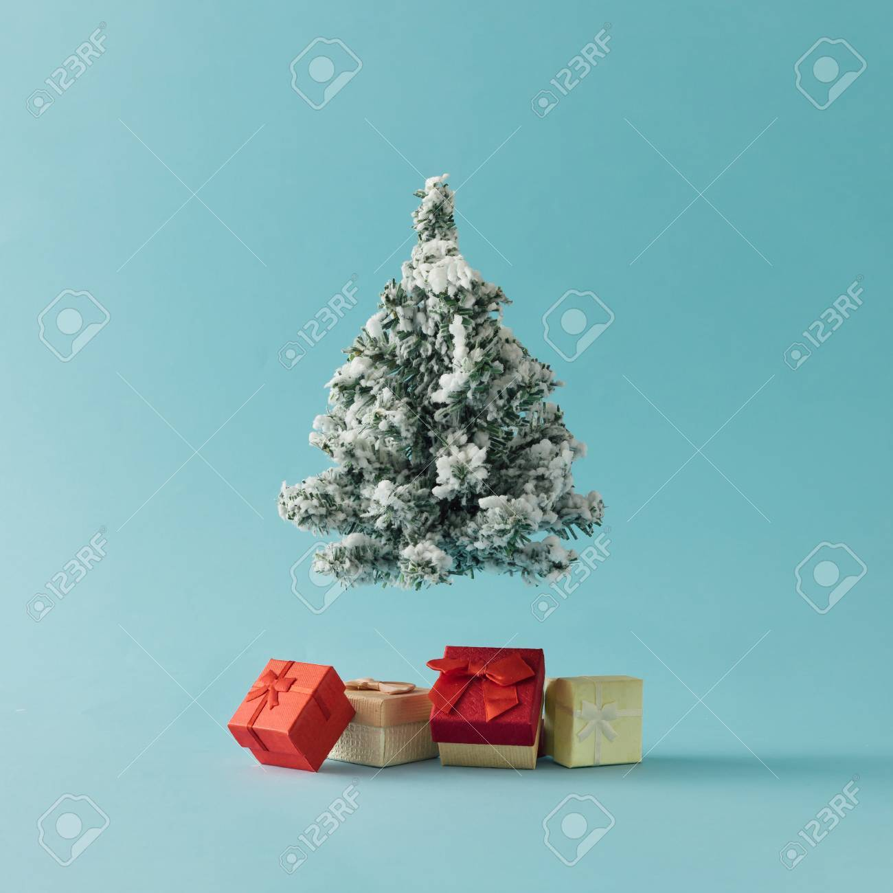 Christmas Tree with gift boxes on bright blue background. Minimal holiday concept. - 90321346