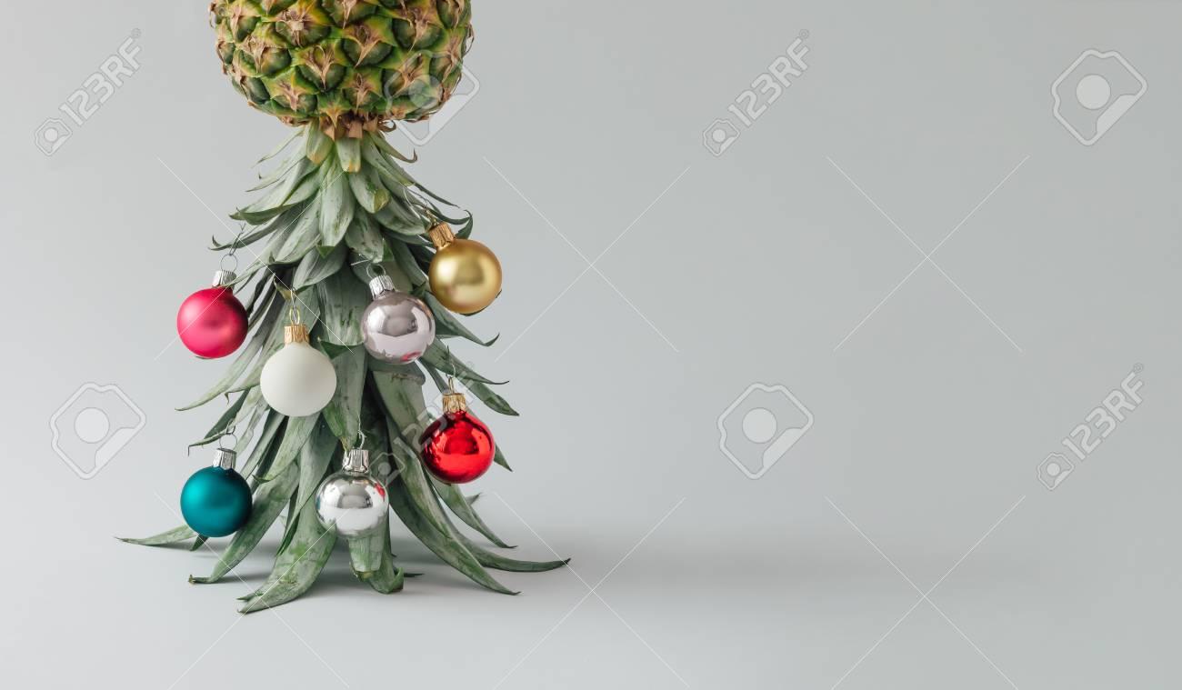 Christmas Pineapple.Christmas Tree Made Of Pineapple And Christmas Bauble Decoration