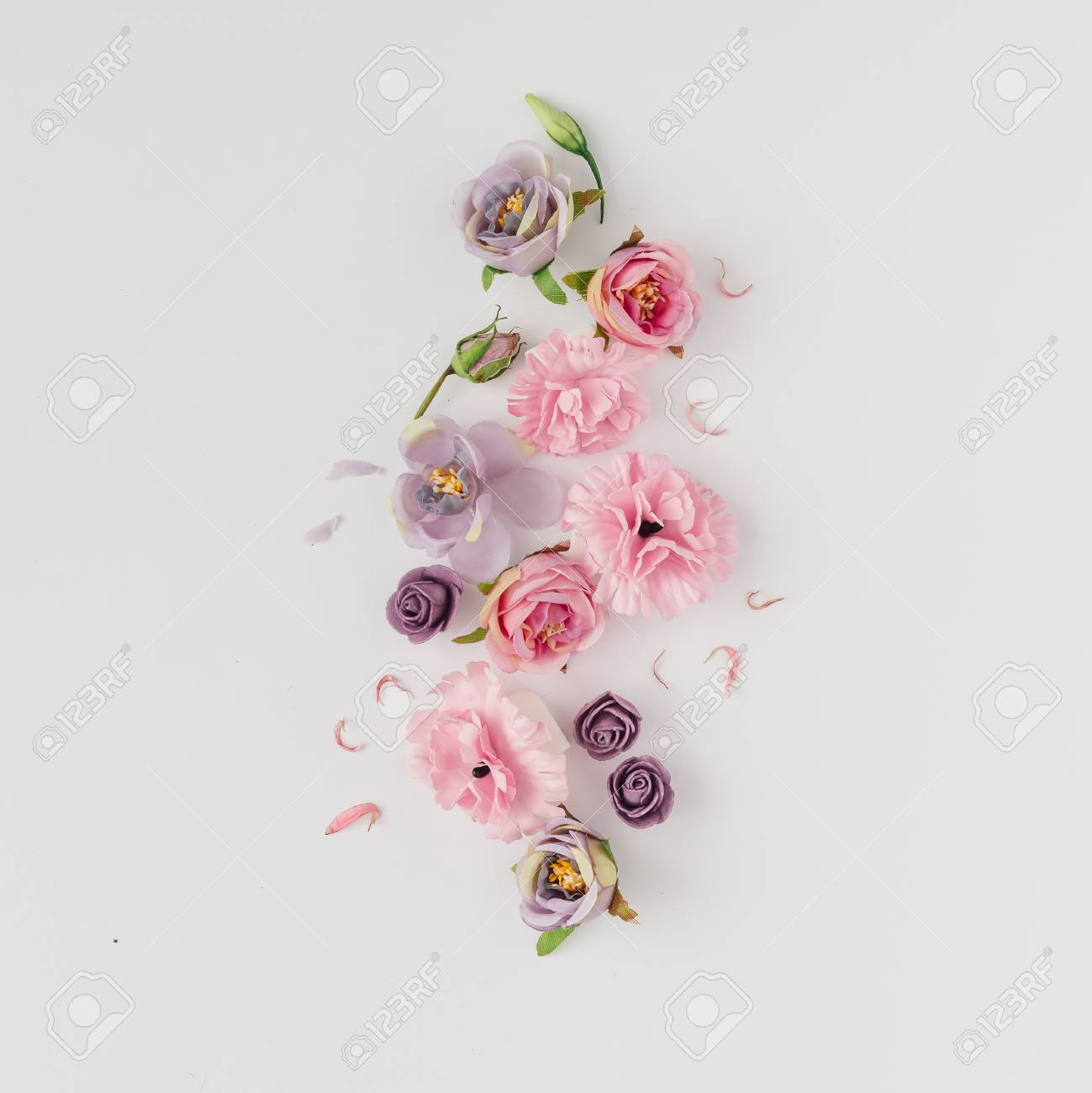 Creative layout made with pink and violet flowers on bright background. Flat lay. Spring minimal concept. - 94909991
