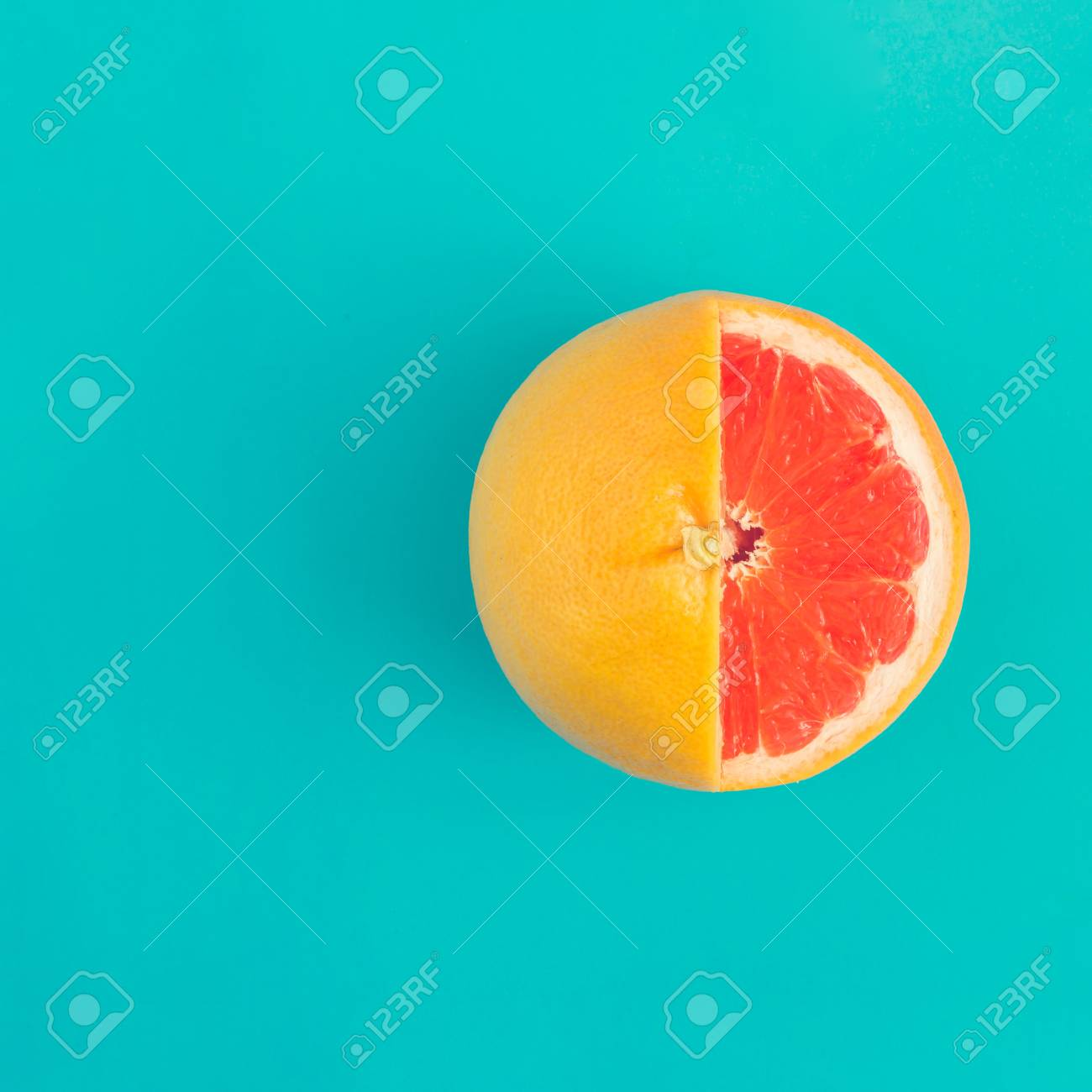 Red grapefruit on bright blue background. Minimal flat lay concept. - 100624816