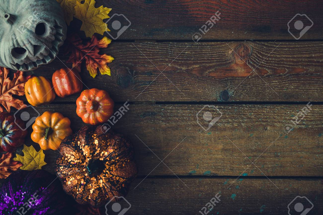 creative autumn halloween layout with various leaves and pumpkins on