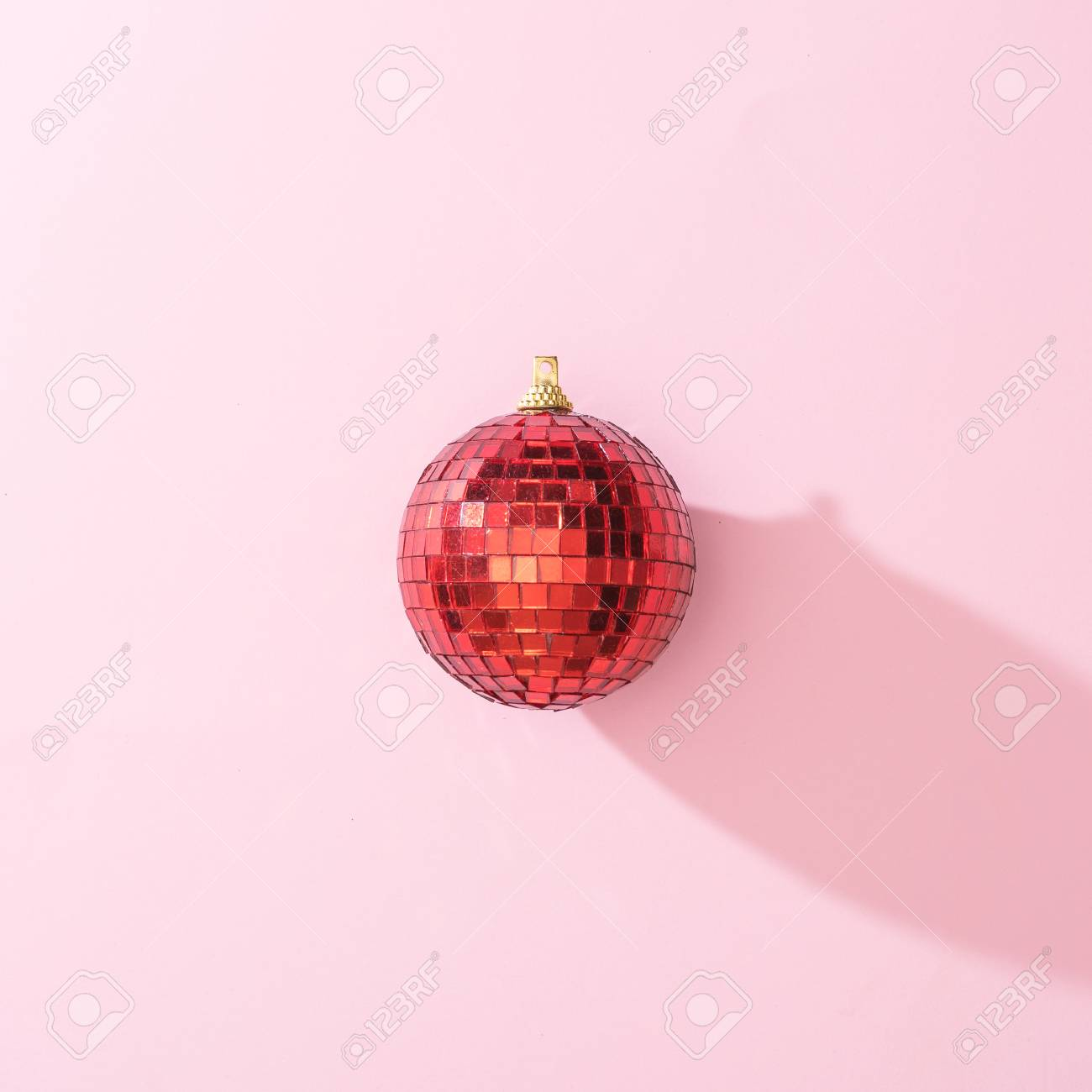 Christmas Disco Ball.Red Christmas Disco Ball Bauble On Pink Background Minimal New