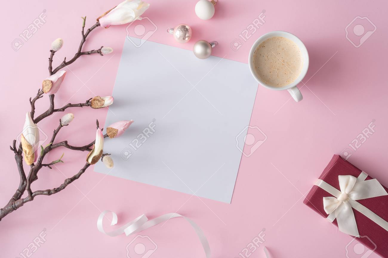White And Pink Flowers On Pastel Pink Background With Paper Card