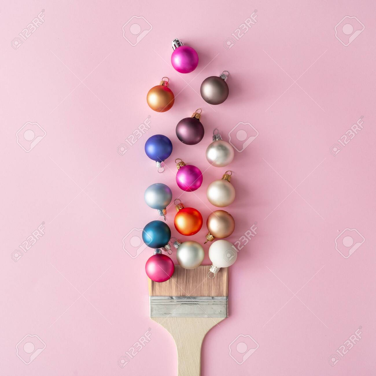 Pastel Christmas Ornaments.Paint Brush With Christmas Ornaments On Pastel Pink Table Minimal
