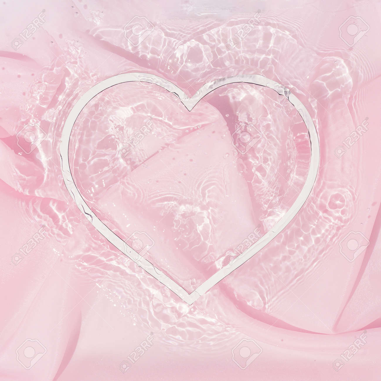 Heart shape copy space in water with silk fabric. Valentines or woman's day background design. Minimal flat lay nature. - 162580138