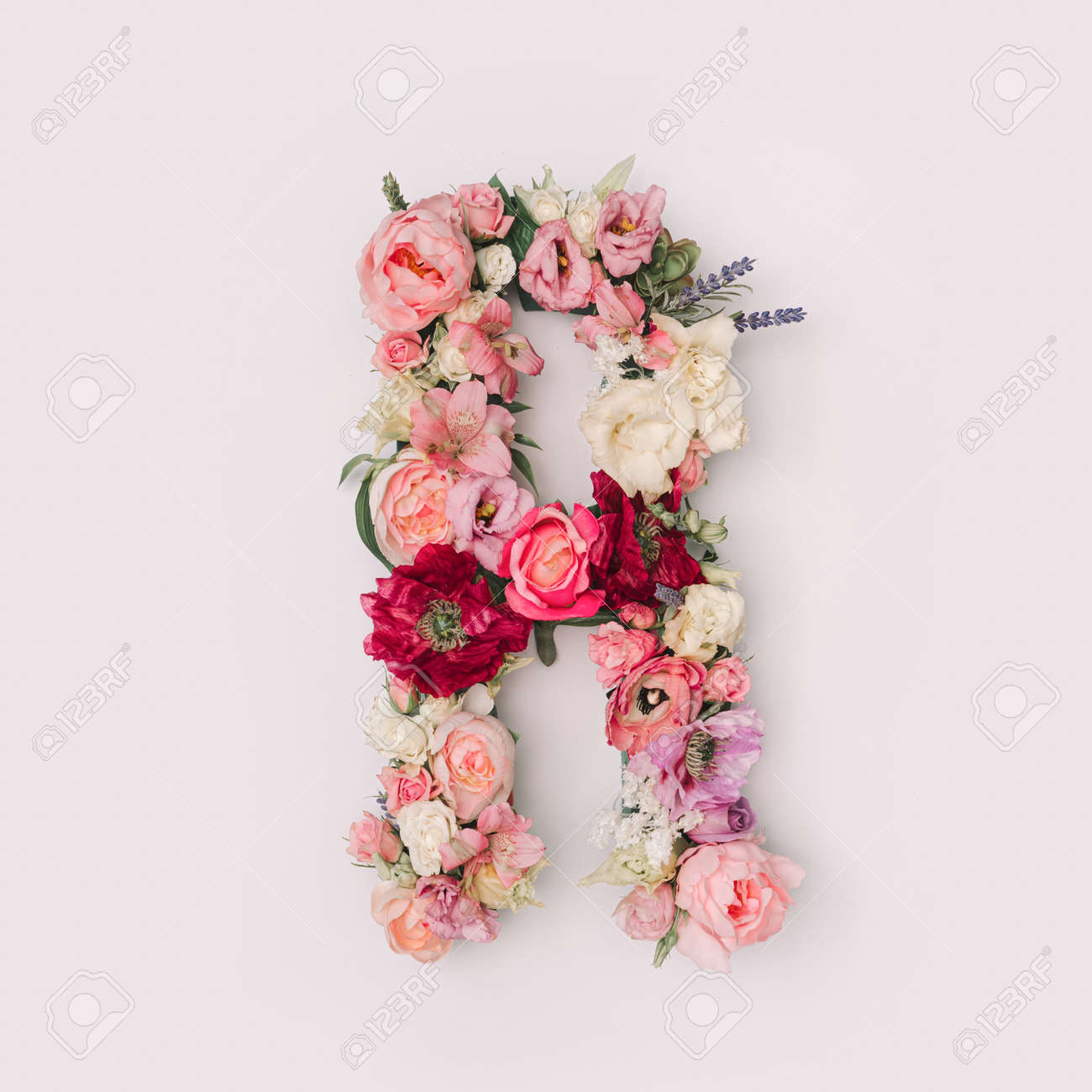 Letter R made of real natural flowers and leaves. Flower font concept. Unique collection of letters and numbers. Spring, summer and valentines creative idea. - 163345600