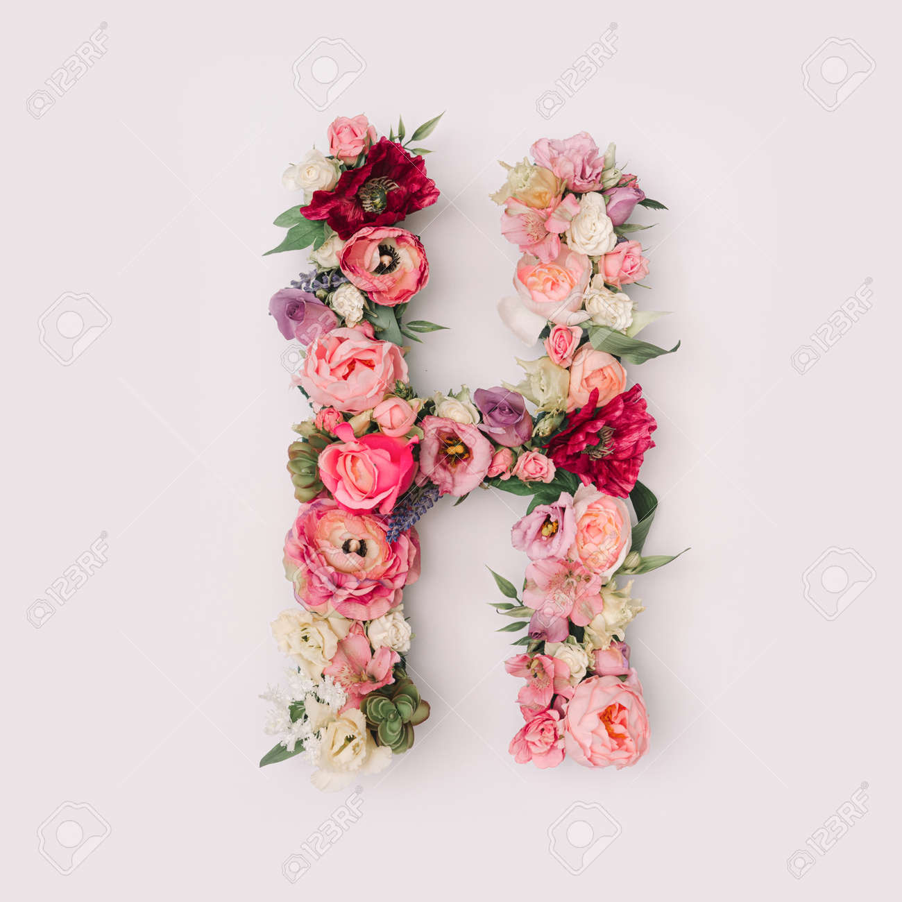 Letter H made of real natural flowers and leaves. Flower font concept. Unique collection of letters and numbers. Spring, summer and valentines creative idea. - 163345985