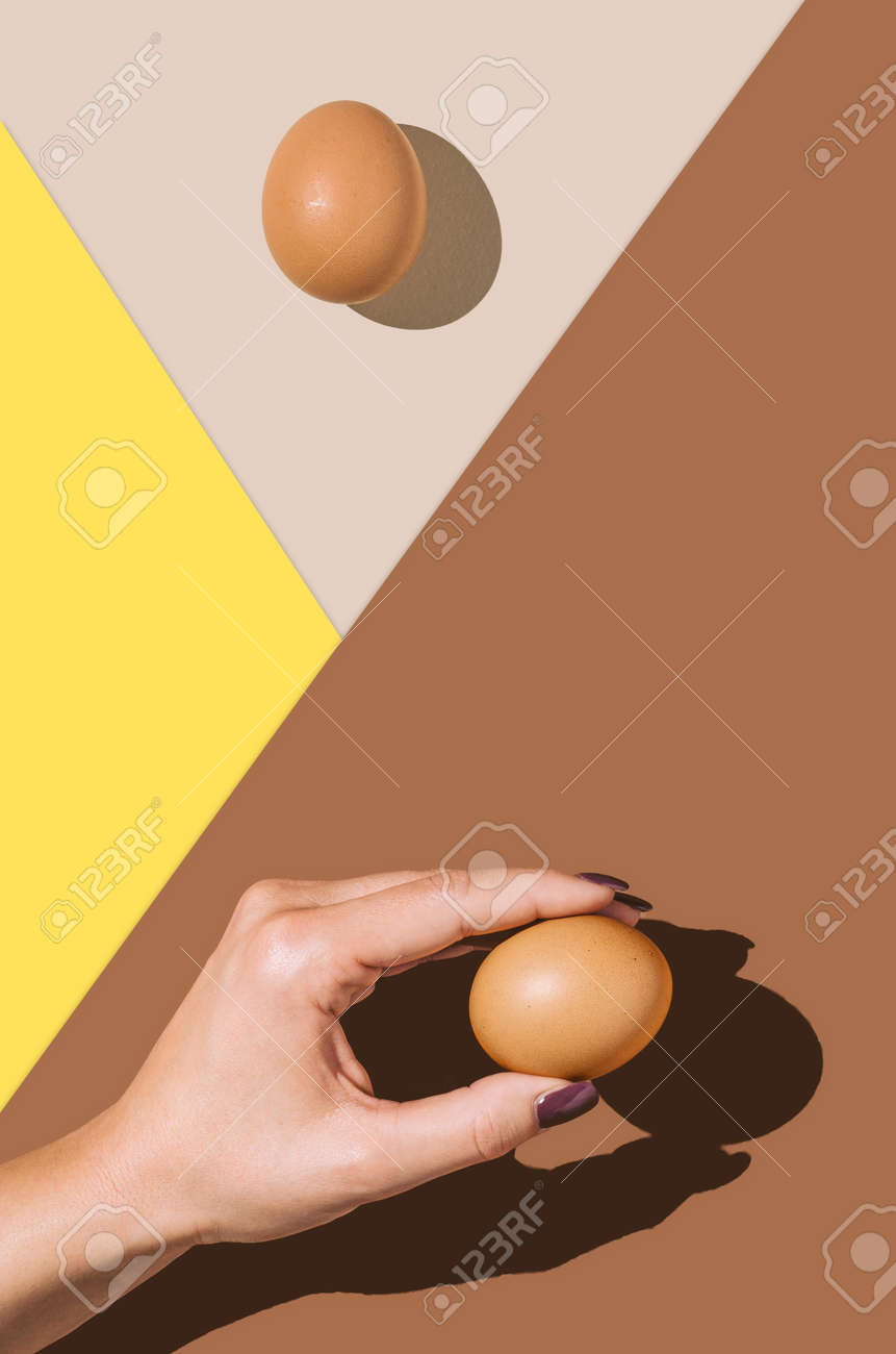 2021 Easter real unique still life composition. Eggs with beautiful woman hand. Flat lay minimal background. - 164636736