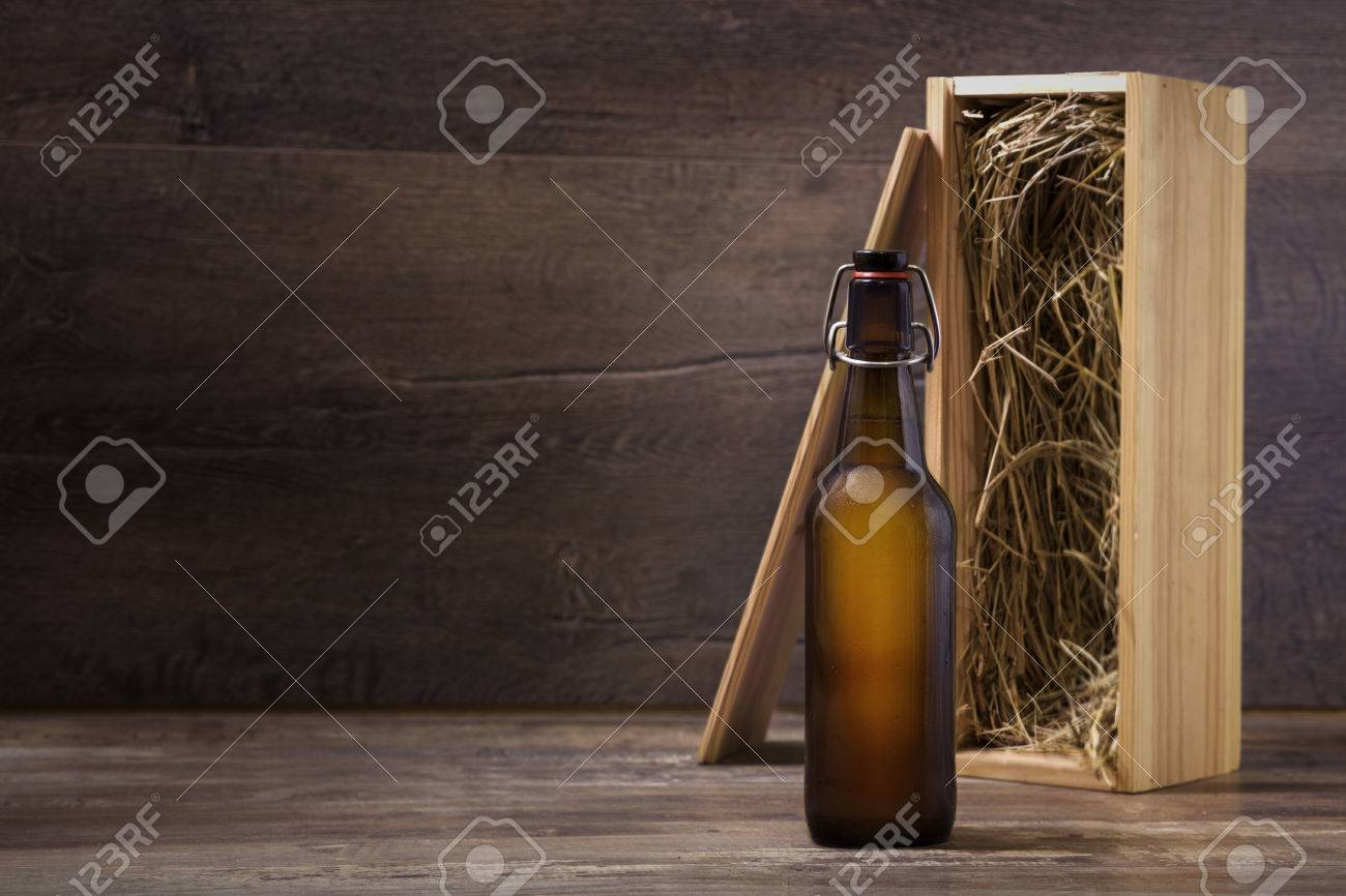 Craft beer gift box - Craft Beer Bottle With A Wooden Gift Box On A Rustic Table Stock Photo 38730099