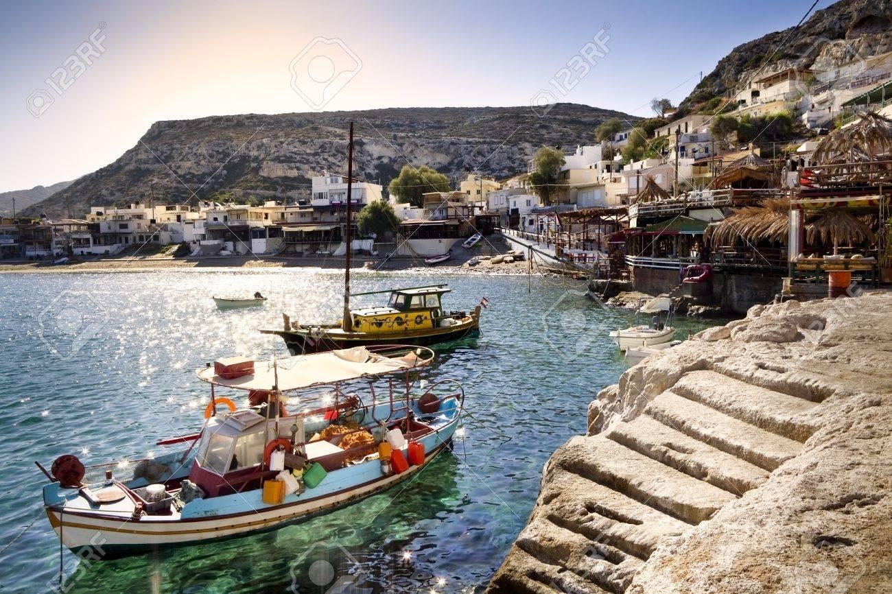 Fishing boats in Matala harbor in Crete, Greece Stock Photo - 19502921