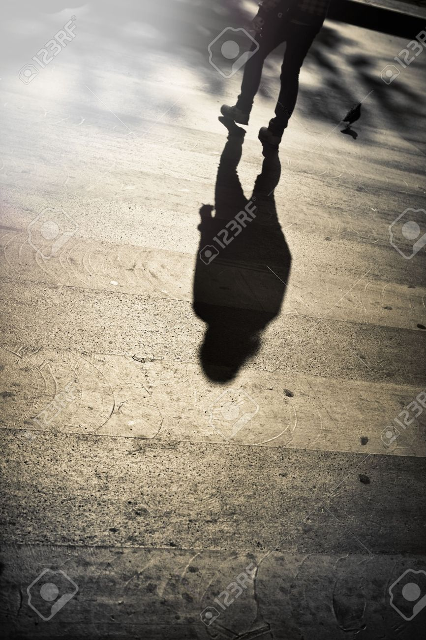 Legs of a lonely man crossing the street Stock Photo - 19457867