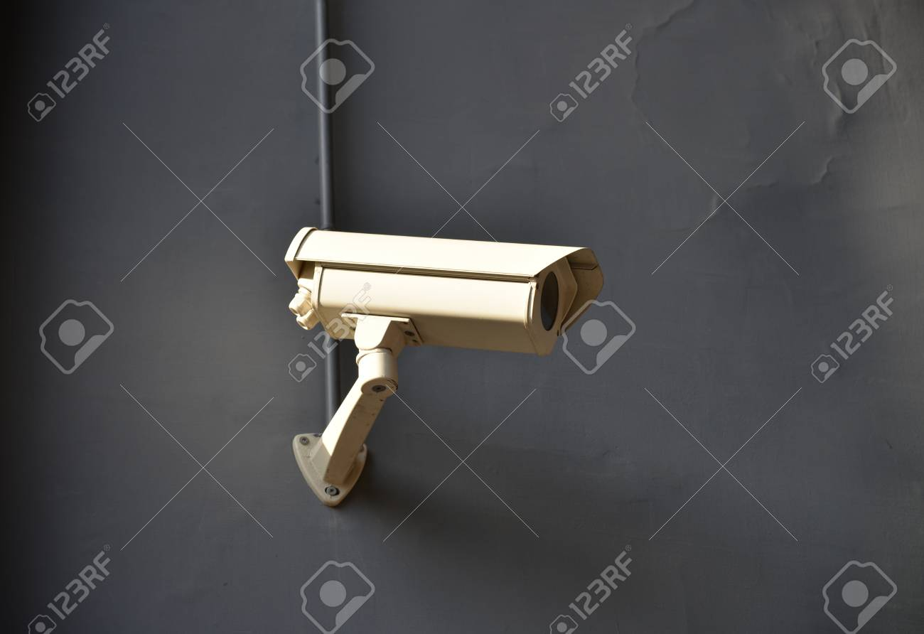 The security camera on a house wall. Stock Photo - 24236426