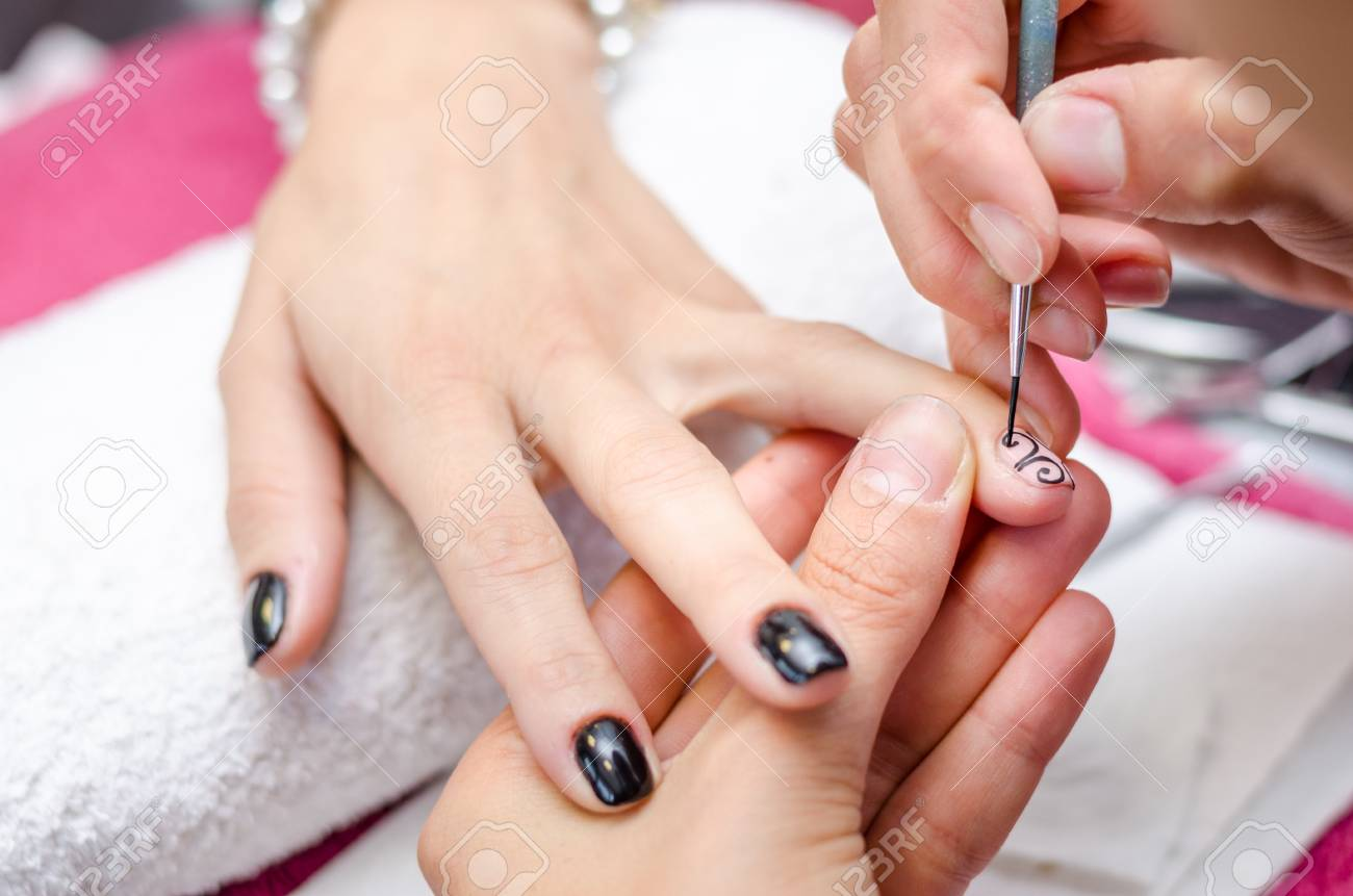 Woman Applying Black Drawing Nail Polish Stock Photo, Picture And ...