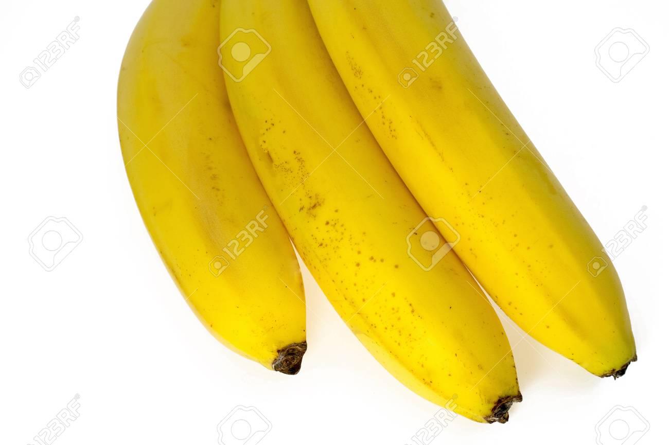 Three ripened yellow, tasty bananas on a white background. Stock Photo - 13846912